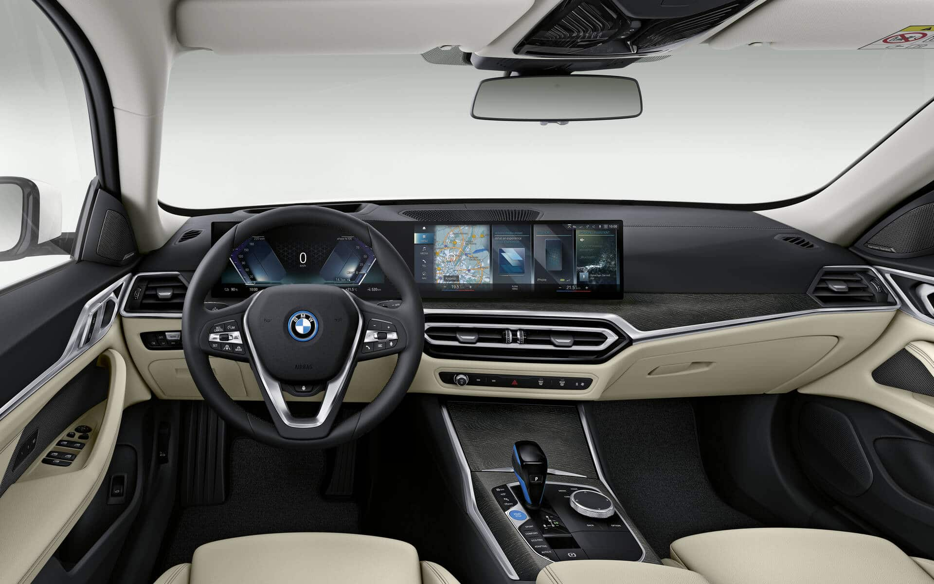The modern and luxurious interior of the 2022 BMW i4. Source: www.guideauto.ca